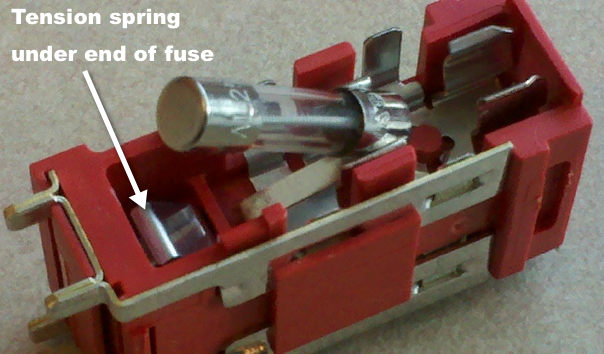 fuse block with fuse pulled up to show metal spring as described