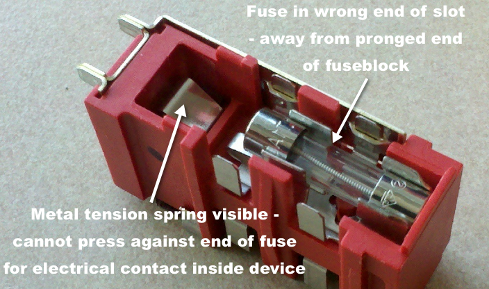 fuse block with fuse installed at wrong end of fuse slot