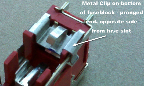 bottom of fuse block with metal clip labelled